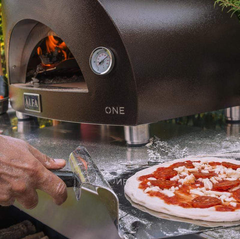 Image of Portable pizza oven Alfa ONE cooking outdoors