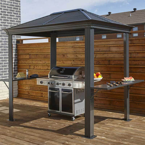 Image of Grill on patio under a Sojag Mykonos grill gazebo with a hard roof
