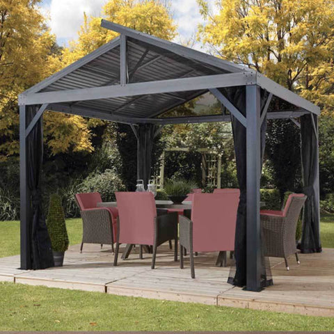 Metal roof gazebo covering patio furniture on a deck