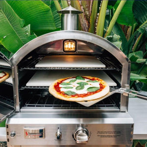 Baking a pizza in the Summerset Countertop Gas Pizza Oven
