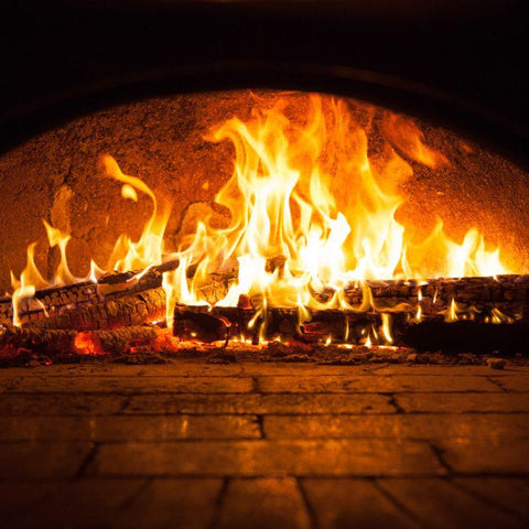 Image of Cooking wood burning in a pizza oven