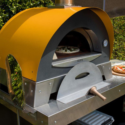 Cooking pizza in a Wood Fired Oven by Alfa Ciao