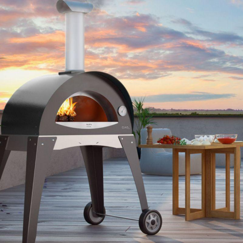 Gray Alfa Ciao Wood Fire Oven on a deck overlooking the sunset