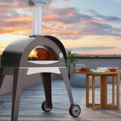 Image of Gray Alfa Ciao Wood Fire Oven on a deck overlooking the sunset