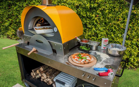Portable Alfa Ciao Wood Fire Oven on a pizza oven table