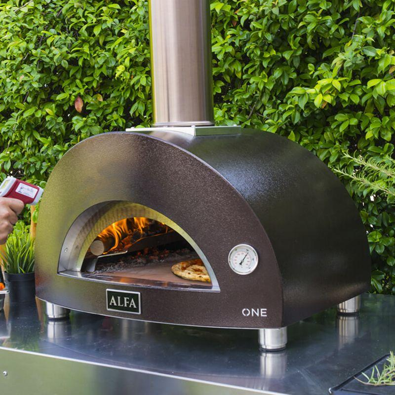 Alfa ONE Portable Pizza Oven cooking a pizza with flames