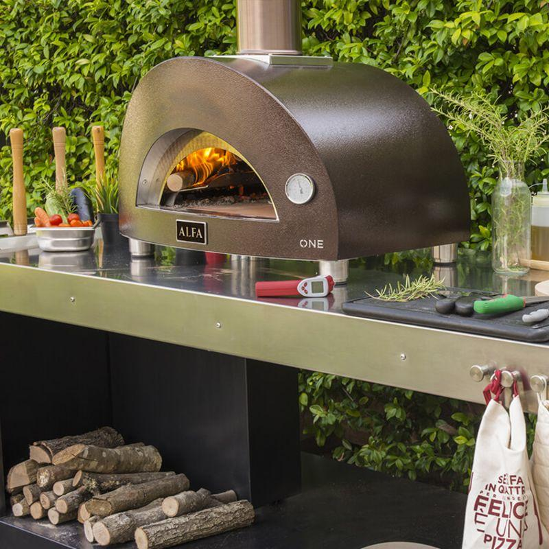 Alfa ONE Wood Pizza Oven on table with fire