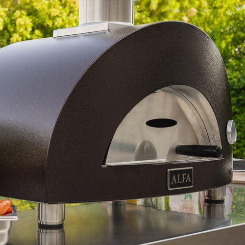 Image of Outdoor pizza oven, Alfa ONE, sitting on a stainless steel table