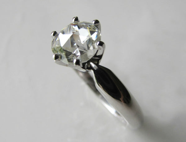 Antique rose cut diamond and platinum engagement ring