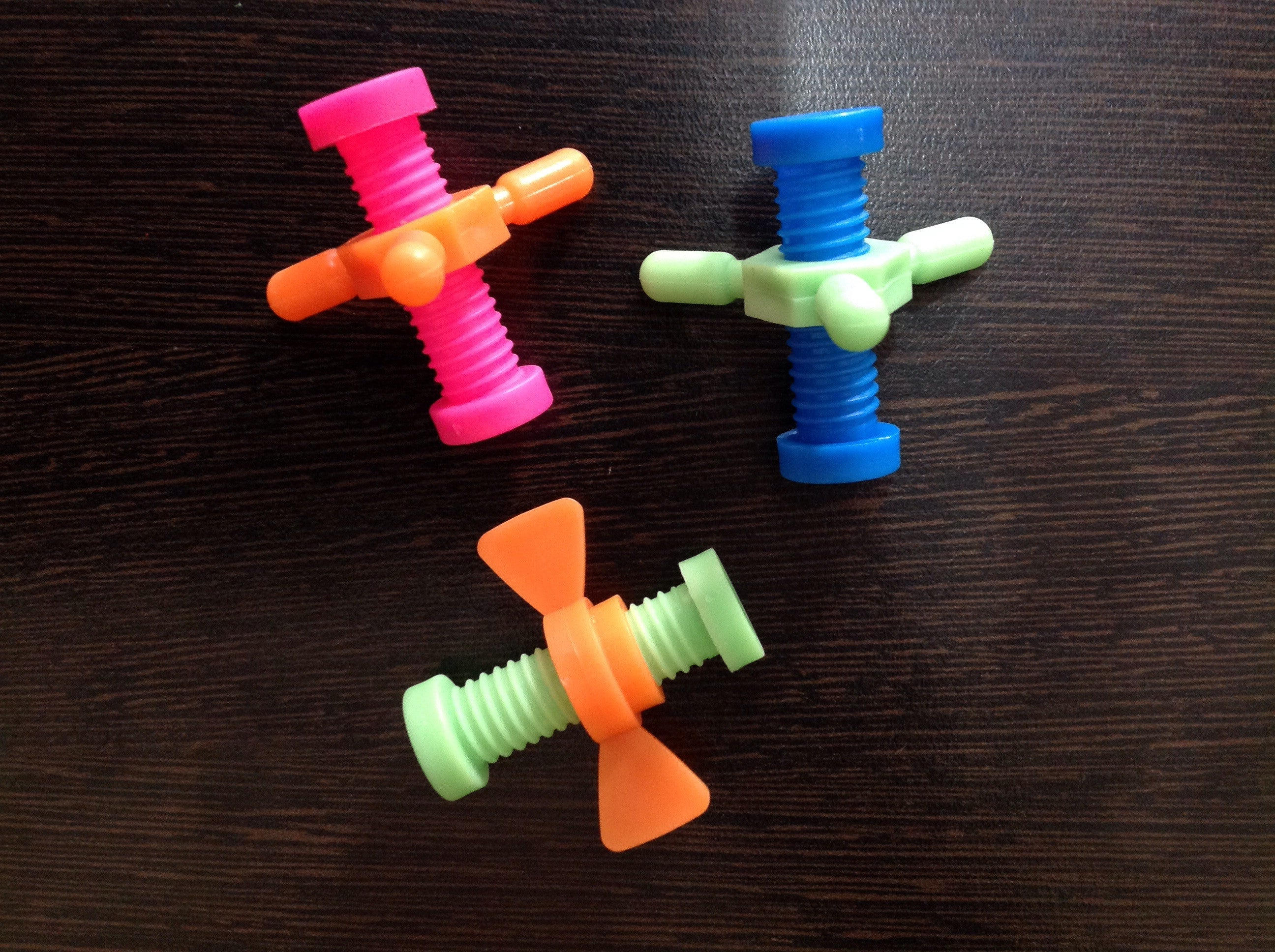 Nut and bolt fidget pencil topper