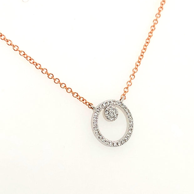 Delicate Diamond Pendant with pave set Diamonds in 14k white gold. suspended from a 14k Rose Gold curb link chain adjustable in length, 17 to 15 inches. Free Shipping.