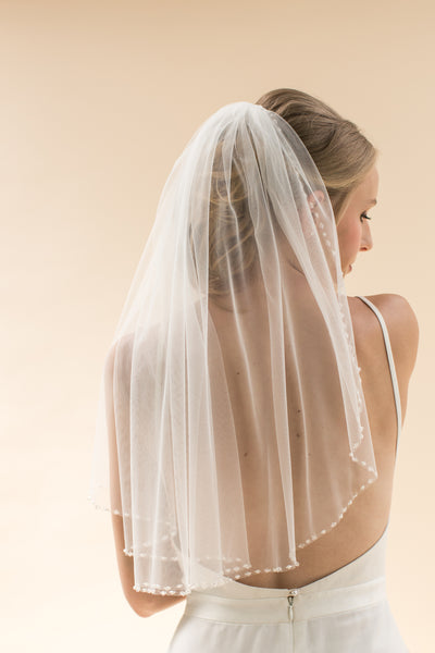 "Rainbow Club's Azalea is a cute short 24"" single-tiered veil a stunning pearl crystal beaded edge"