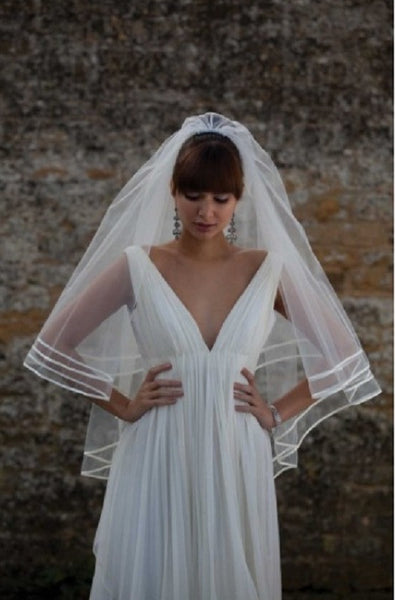 Joyce Jackson Barbados Veil is a two tier veil in classic tulle with two rows of satin ribbon edging