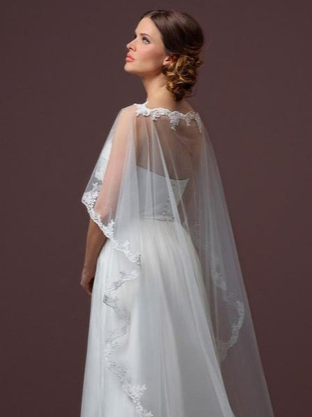 Poirier Soft Tulle Bridal Cape With Train C50-200 by Jupon a soft tulle cape featuring luxury lace
