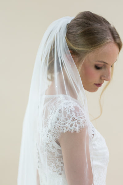 "Rainbow Club's Cheerfulness is a classic single tier 42"" hip length veil for Pink Daisy Bridal"