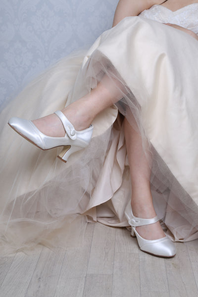 Esta shoe is a vintage inspired Mary Jane styled shoe in ivory satin for Pink Daisy Bridal
