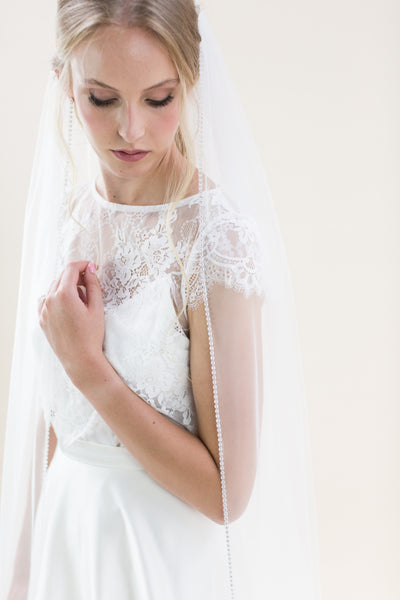 "Long and luxurious, Rainbow Club's Flame 96"" train length veil for Pink Daisy Bridal brides"