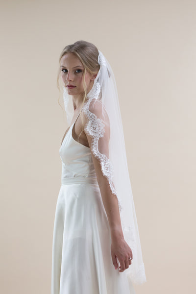 A stunning new style Rainbow Club's Gardenia is a hip length single tiered wedding veil