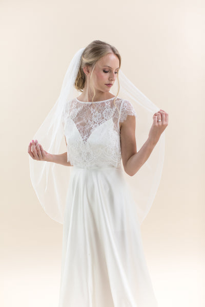 Rainbow Club Hydrangea pearl edge veil is a simple yet stunning hip length wedding veil