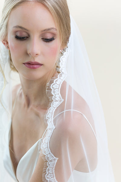 Rainbow Club Ivy is a full length single tiered wedding veil made from exclusive Ivory Italian Tulle