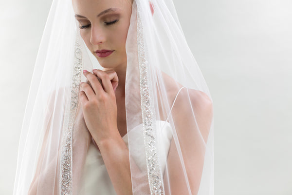 "Lucca is an Ivory Sheer Tulle Veil by Joyce Jackson, and is a stunning 96"" Train length veil"