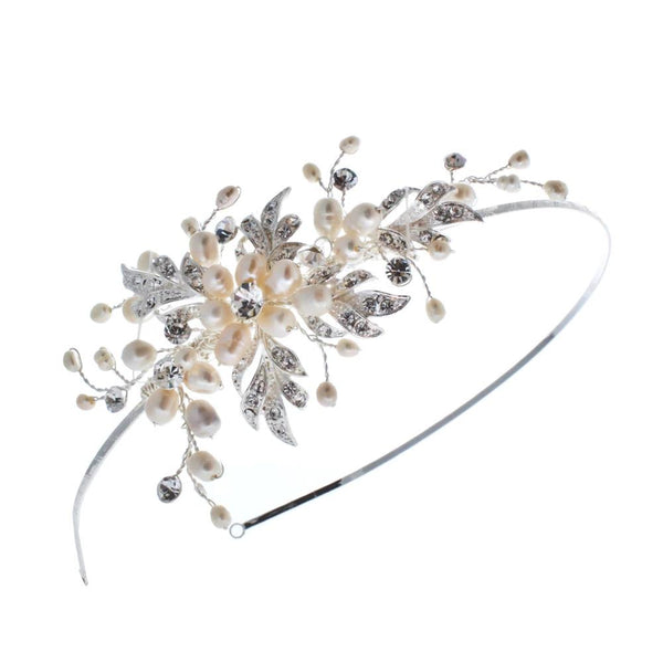 Pink Daisy Bridal the pretty accents of the Paris Side Tiara deliver charm to any bridal outfit