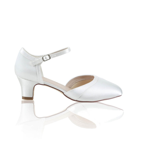 With soft, cushioned leather lining and insole on a neat little heel, ankle strap for support