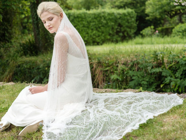 "This Romance from Rainbow Club is a show stopper! A full length 78"" veil in ivory lace tulle"