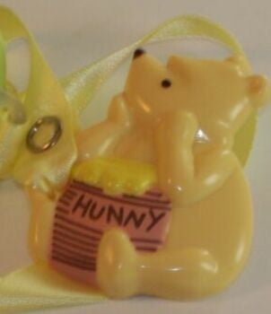 "<div style=""display: none;"">8390</div> cream 3D Winnie the Pooh Dummy Clip with adult length yellow ribbon"