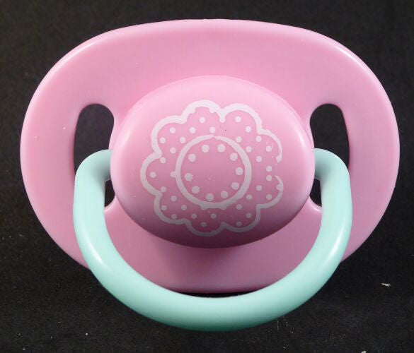 "<div style=""display: none;"">9326</div> Pink with white flower pattern decoration  dummy with Nuk teat"