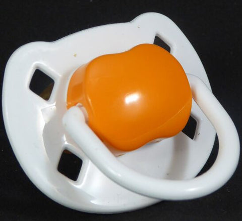 "<div style=""display: none;"">9474</div> White & orange Spanish style dummy with Nuk teat"