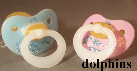 "<div style=""display: none;"">9976</div> NUK Pacifier decorated with dolphins."