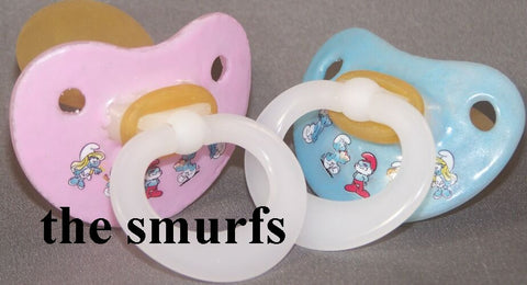 "<div style=""display: none;"">9972</div> NUK Pacifier decorated with The Smurfs."