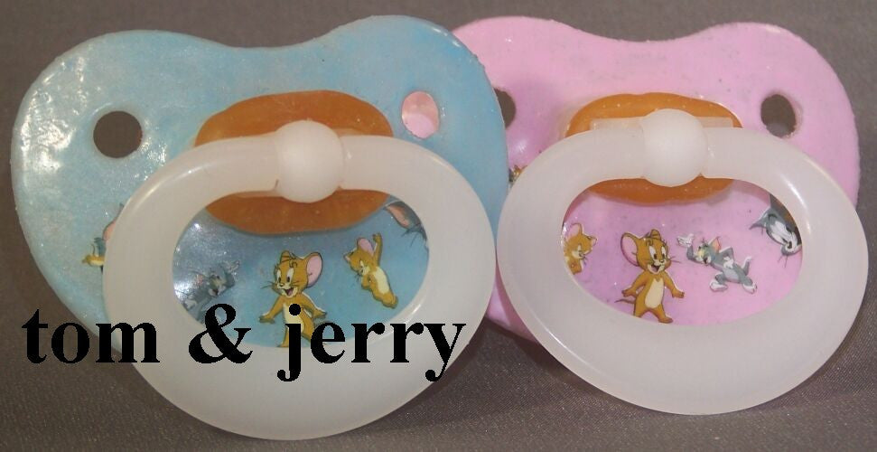 "<div style=""display: none;"">9970</div> NUK Pacifier decorated with Tom and Jerry."
