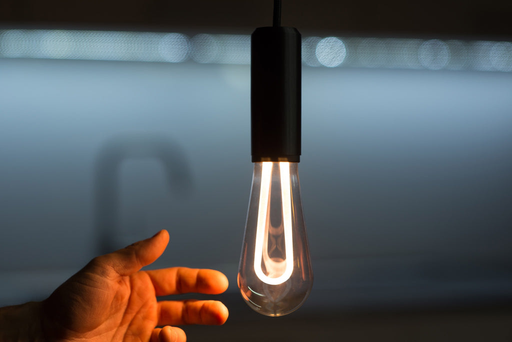 LED light bulb ARC with a hand reaching to it