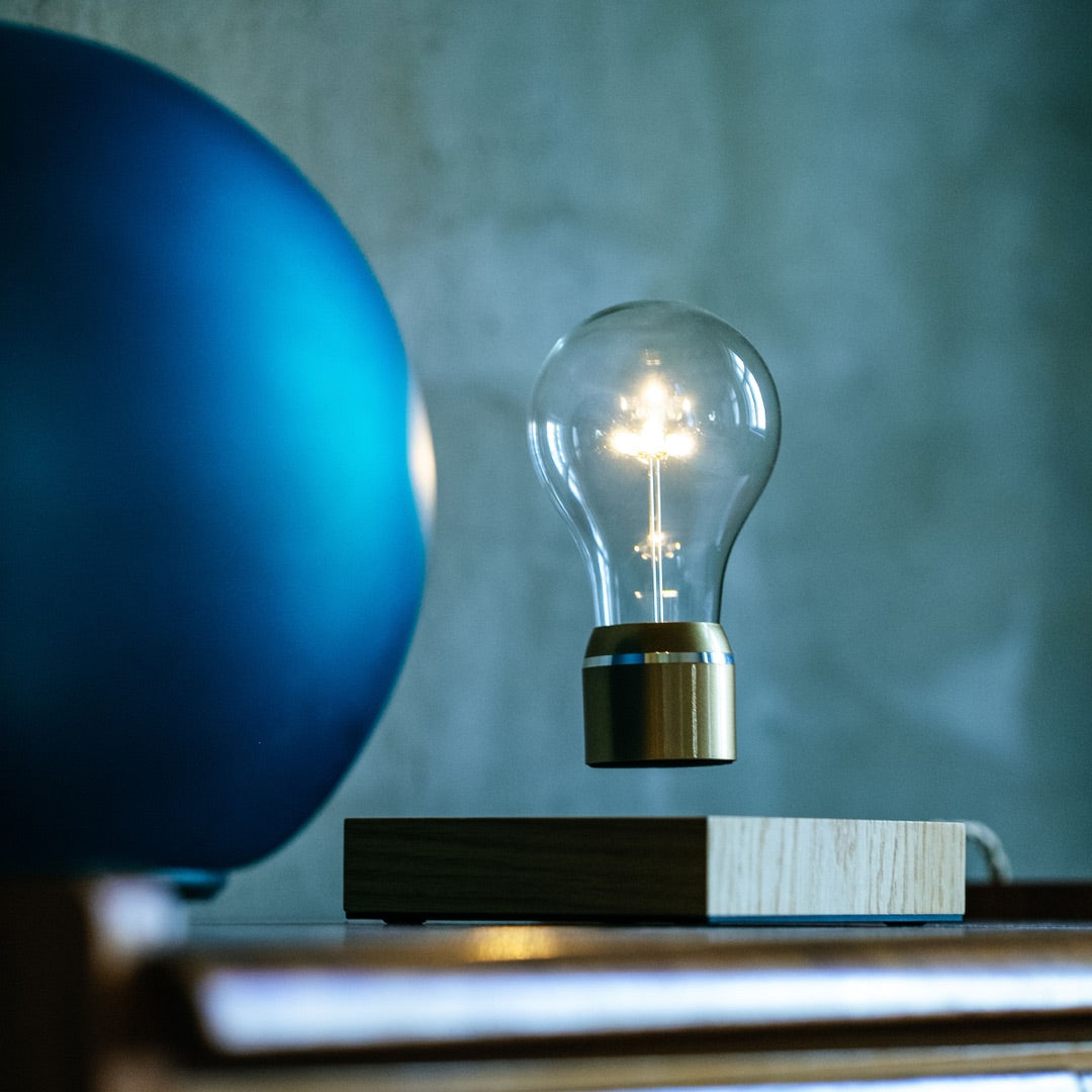 Levitating light bulb royal on brown table side view