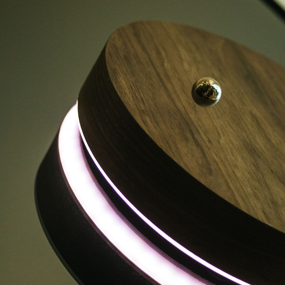 levitating clock on a mirror close up shot
