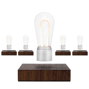 Levitating light bulb FLYTE NIKOLA model combines a classic, rich-toned Walnut base with innovative MARCONI bulb in Chrome.