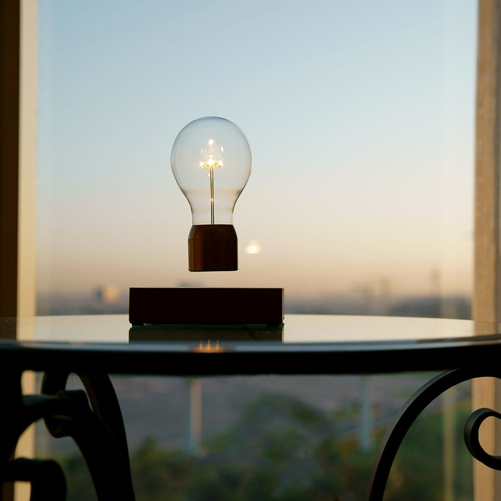Lifestyle image of FLYTE Levitating light bulb Royal with a view to city