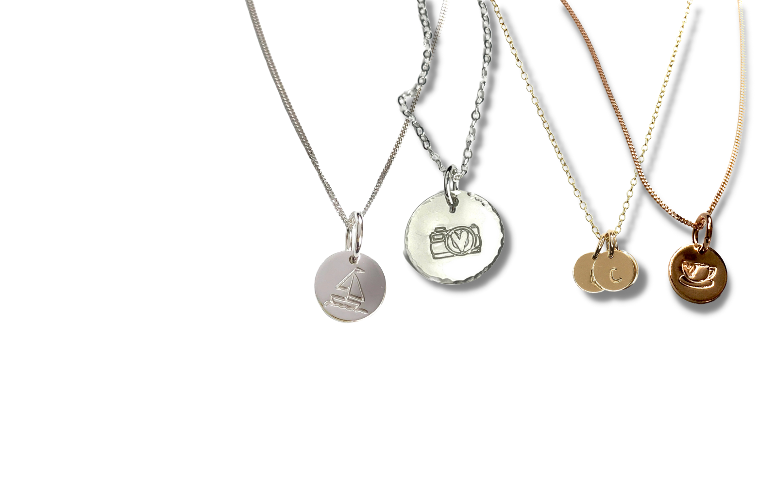 Round disk necklaces that can be hand-stamped with different symbols or words.  Personalize them how you like