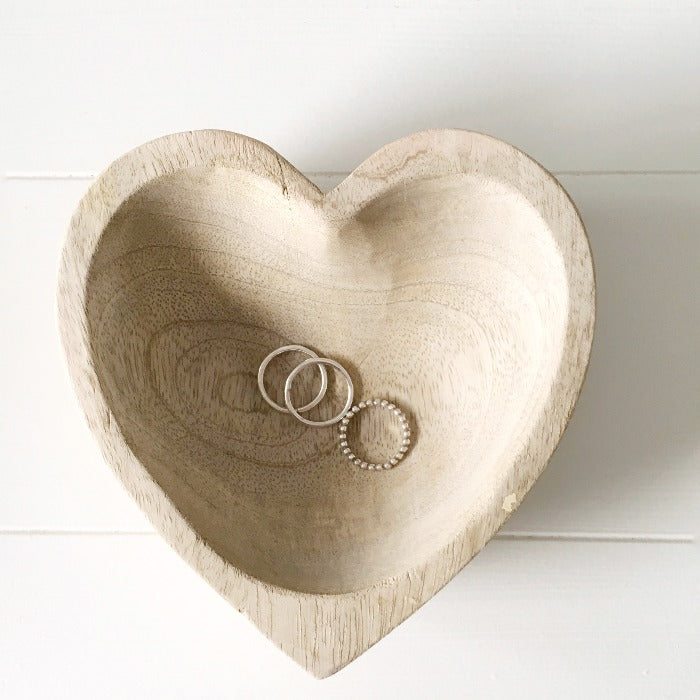 The Silver Trio Ring Set in a wooden heart shaped bowl