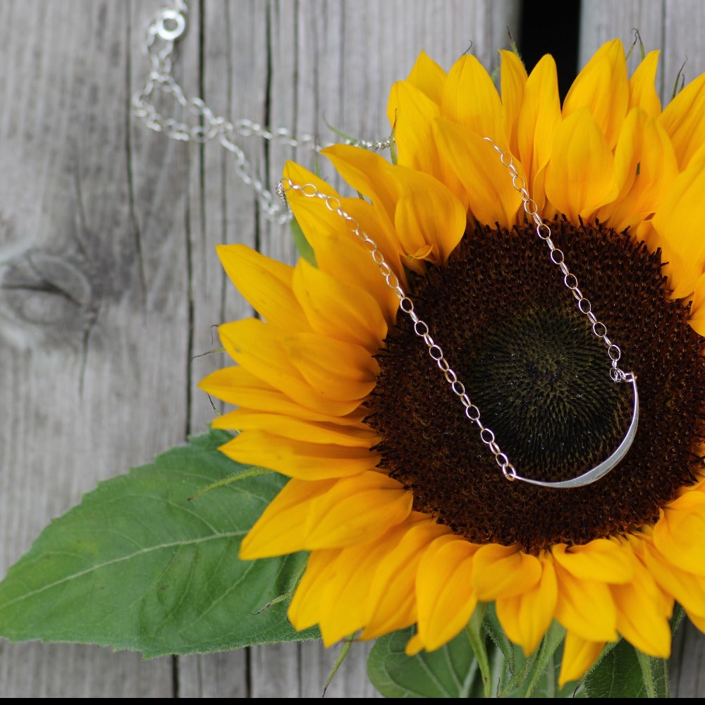 The Harper necklace on a sunflower head