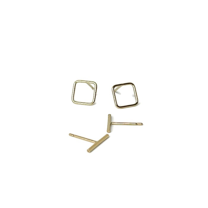 Dash studs in gold with other square earrings