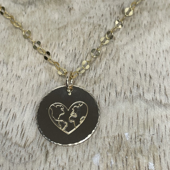 A world of Love Necklace on a wood background