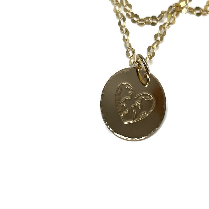 A World of Love necklace, up close view of hand-stamped heart