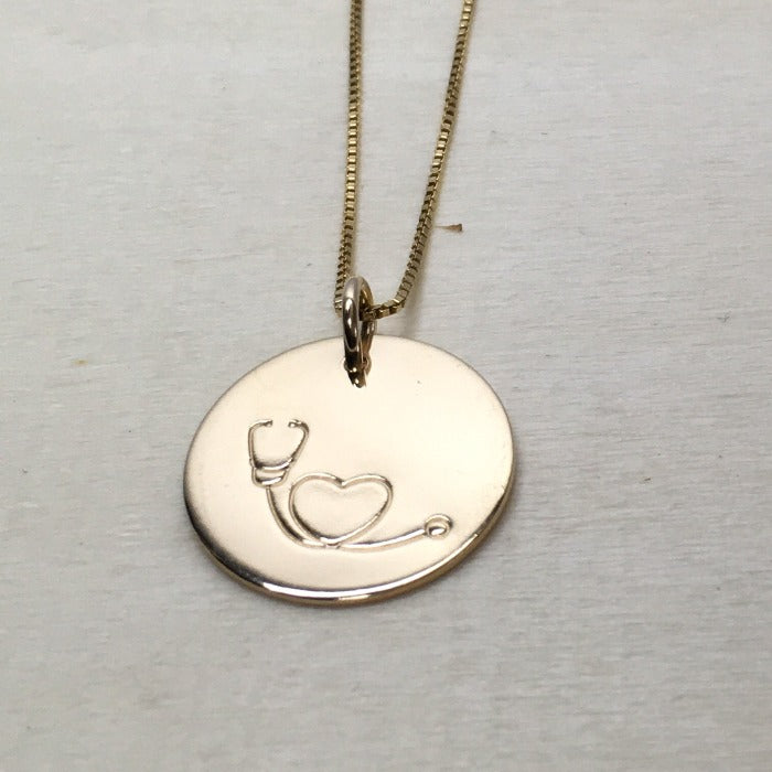 Stethoscope necklace in gold