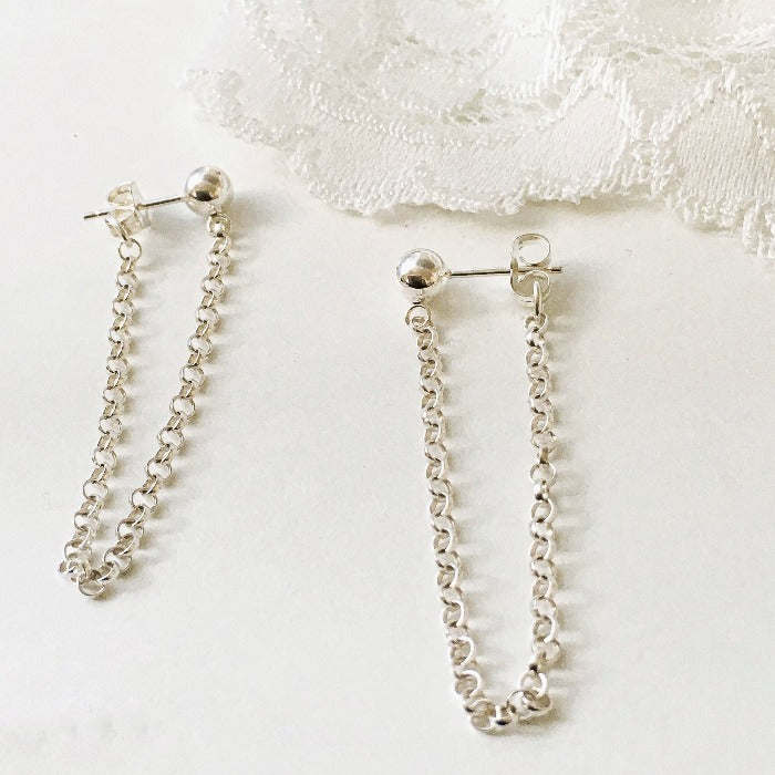 Catena Chain earrings lying side by side on a white background
