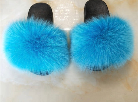 Torquoise blue fox fur slides