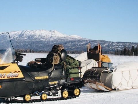 snowmobile with wood toboggan