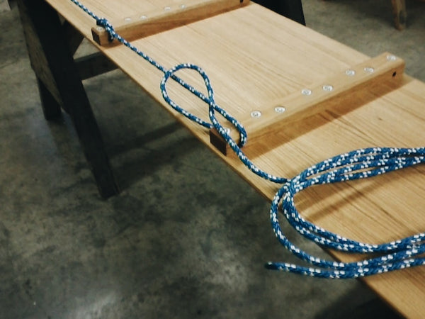 In the workshop: Length of rope lying curled on the toboggan deck